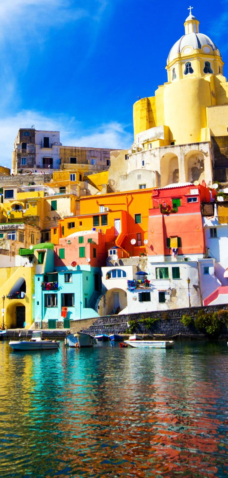 Basque in the Mediterranean sunshine and enjoy the Italian hustle and bustle of the vibrant streets of Naples. Soak up the atmosphere and eat fresh delicious, Italian food.   Procida - Island in the mediterranean Sea Coast, Naples. Italy   15 Most Colorful Shots of Italy #Mylifemystyle