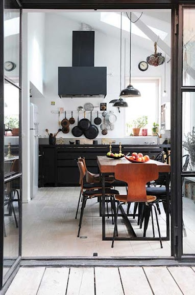 Wow fantastic - love the black cabinets, little bit of wood, rest clean crisp white and the iron/metal doors