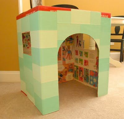 little playhouse from a cardboard box - this is SO great. And also inexpensive. A great DIY idea (with tutorial). Wouldn't this be a great BIG present to see on Christmas Morning?! #giftidea
