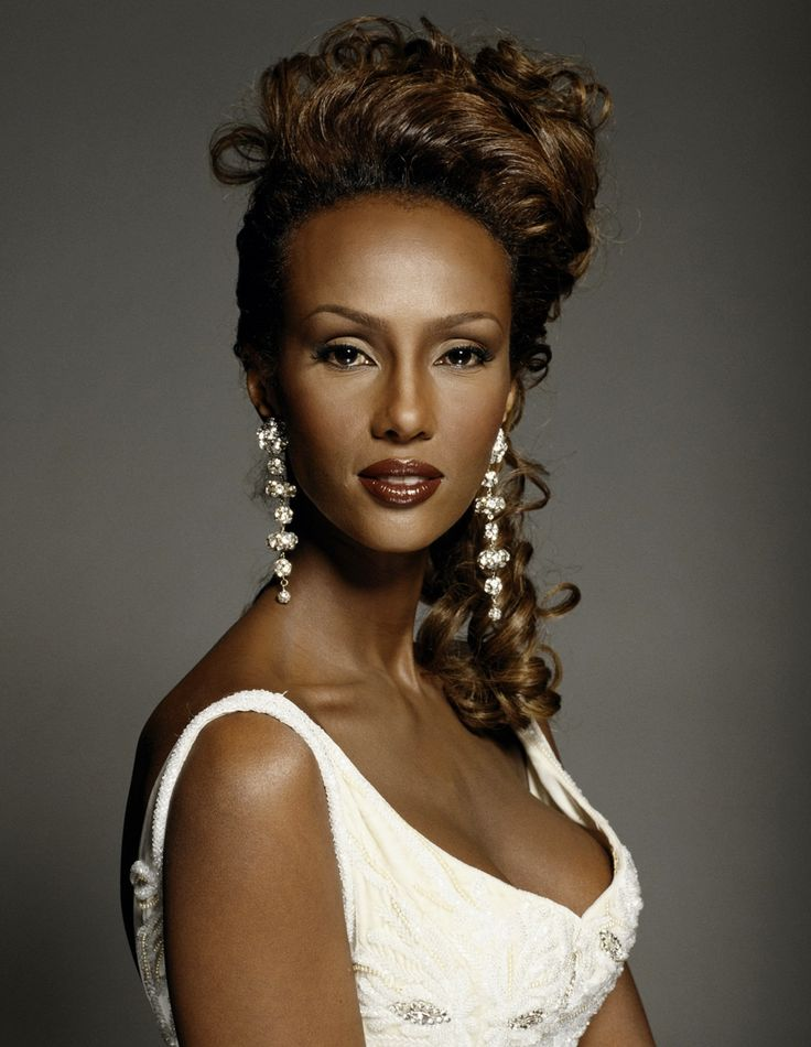 Iman (born Iman Mohamed Abdulmajid), Somali supermodel, actress & entrepreneur. She became a muse for many prominent designers, including Halston, Gianni Versace, Calvin Klein, Issey Miyake, Donna Karan, and, in particular, Yves Saint-Laurent. A pioneer in the field of ethnic cosmetics, she started her own company, Iman Cosmetics, a $25M/year business. She is also noted for her charitable work. She is the widow of rock legend David Bowie.