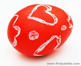 Decorate Easter eggs by drawing on them with wax crayons before dying or painting. The areas covered with crayon wax will resist the dye and create wonderful patterns on the Easter eggs.