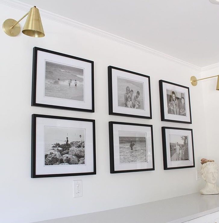 Classic black and white gallery wall. Love the sconces too!
