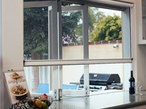 Love the retractable screen for bi-fold windows in kitchen - can still open for a servery