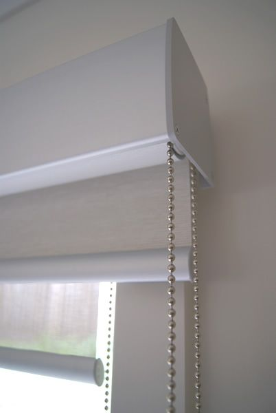 This picture shows a valance that was measured 50mm past the edge of the architrave on both sides.  Front rolled inside mount sunscreen blind and back rolled outside mount blockout blind.