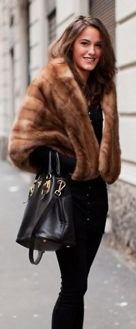 (it's faux)   I have a real fur from my Mom from the 50's just like this that I love to wear with jeans and boots.