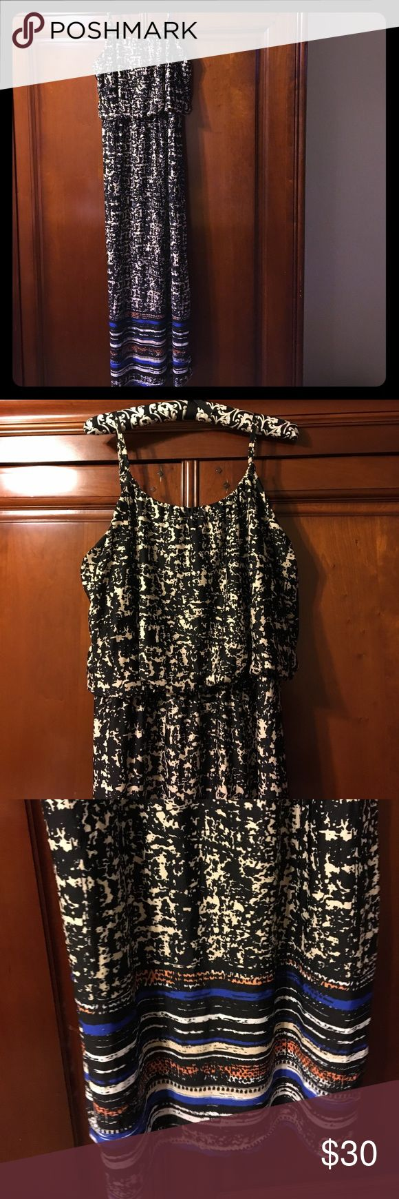 Pretty Maxi dress black & white w/ blue & orange So pretty. Can wear this dress casual or dress up with nice shoes and jewelry;) empire waist, scoop neck with adjustable spaghetti straps. Has pops of orange and blue on the bottom of dress. majic Dresses