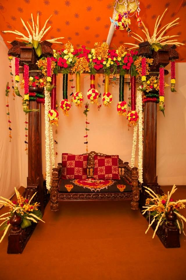 Jhula with flower decorations and parrots