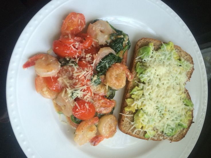 Spinach tomato garlic shrimp with Parmesan and a slice of fiber bread with avocado spread and mozzarella -400calories!