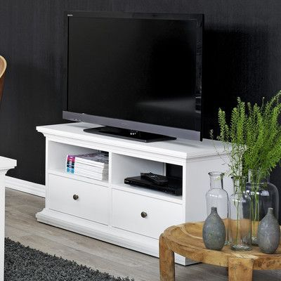 Super small tv stand. I would change out the knobs to something to give the piece a POP
