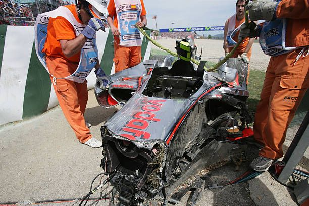 The damaged car of Heikki Kovalainen of Finland and McLaren Mercedes is seen at the side of the track during the Spanish Formula One Grand Prix at...