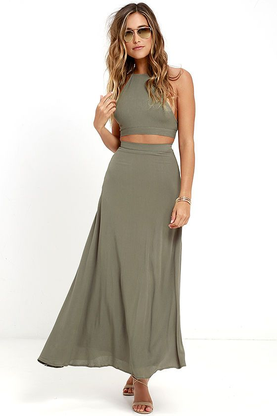 Strut your stuff like the true queen you are in the Walking on Heir Olive Green Two-Piece Dress! Breezy woven rayon forms a halter crop top, with adjustable spaghetti straps that crisscross above the tying back. A high-waisted skirt cascades to a maxi length. Hidden back zipper/hook clasp.