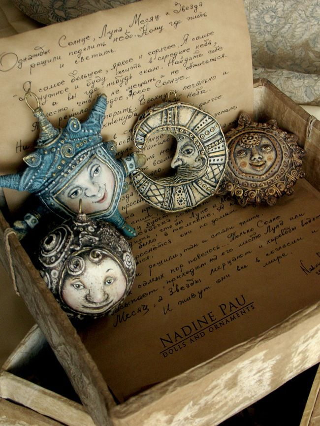 "by Nadine Pau. Christmas ornaments. ""Parcel post from the past."" Papier mache, oil patina varnish. sold #christmasornaments #nadinepau"