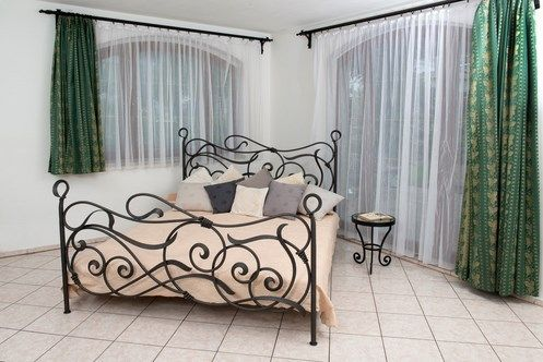 Although it's made of durable, solid wrought iron, the Beletti Design Colette Bed has a soft, natural look due to the organic forms and waves that make up its design. These forms are complemented by the presence of spirals in a variety of sizes. Coils are featured throughout the design to hold forms together, increase the strength of the bed and add to its style.
