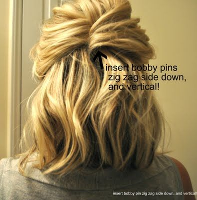 Start with curled/waved hair 1. Pull a section from one side of your head back to the center and insert bobby pins vertically. 2. Then grab a section from the opposite side, bring it back to the section, flip it around and insert bobby pins on the underneath section.