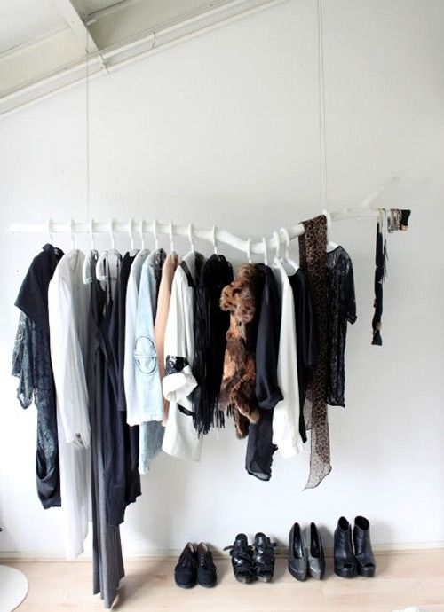 open wardrobe made from a white painted branch