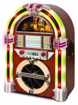 The Timeless Northwest Juke Box: Absolute must have for your man cave. Sit it on the end of the bar and enjoy your tunes all night long. Way more practical than a full size one and about a tenth the price. CD Jukebox With AM/FM Radio.Decent output and lights up the room.Auxiliary jack and cord allows you to connect iPads, i... See it: http://www.podies.com/the-timeless-northwest-juke-box/
