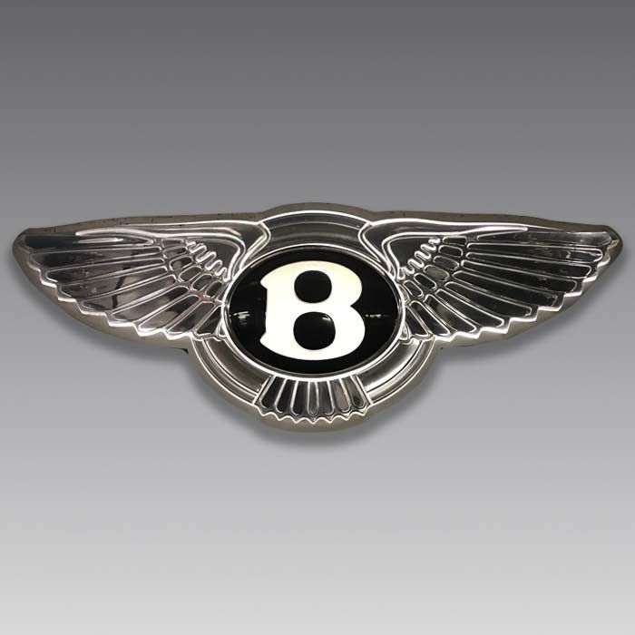 This stunning sign features the iconic Bentley winged motif and was originally created for the Exeter dealership, which was owned by Danny Donovan of Straight Eight. Manufactured in metal and plastic, it is cleverly lit from within so that both the wing outline and the legendary 'B' logo are beautifully illuminated with white light. It runs on a standard UK power supply.