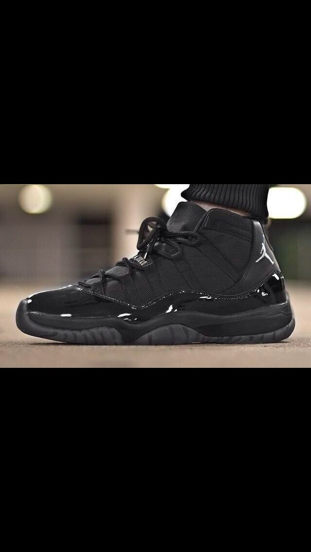 All black Jordan 11's