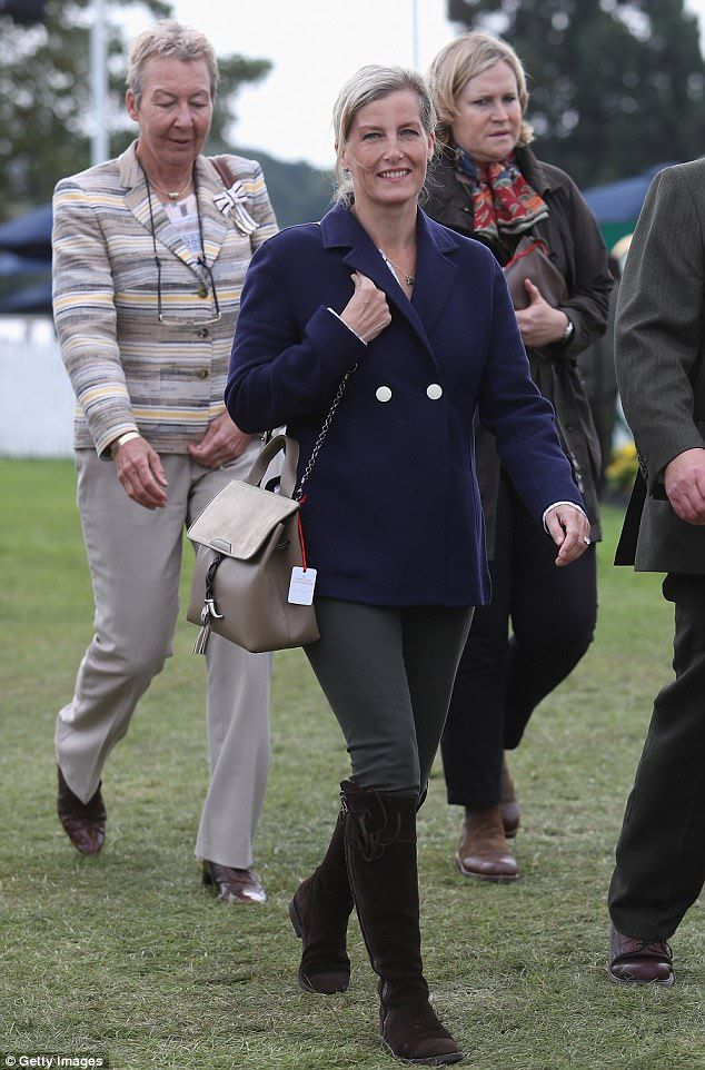 Country living: The countess donned boots for the Burghley Horse Trials in September...