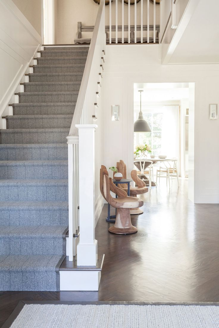 Traditional treads with a chunky newel post give this stairwell a modern twist.