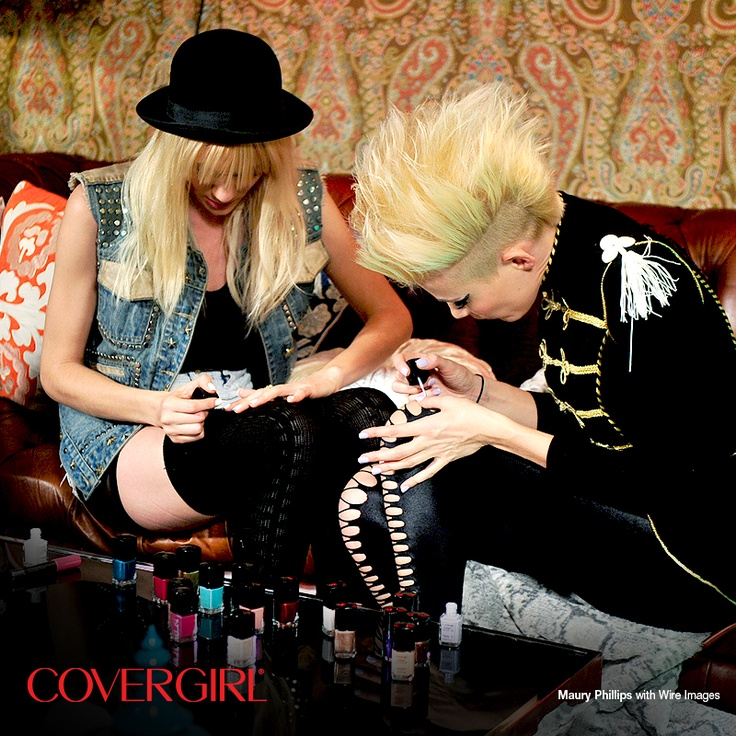 COVERGIRLs NERVO paint on a pop of Outlast Stay Brilliant Nail Gloss color before they hit the stage at the Top DJ's Dance Party hosted by Rolling Stone.