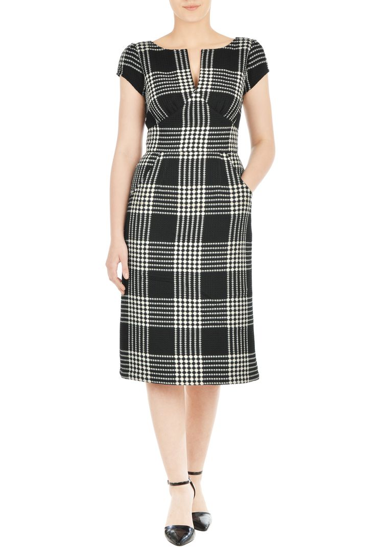 Our waffle check dress is styled with a split boat-neck and a curved empire waist to add just the right fit for our retro-inspired silhouette.