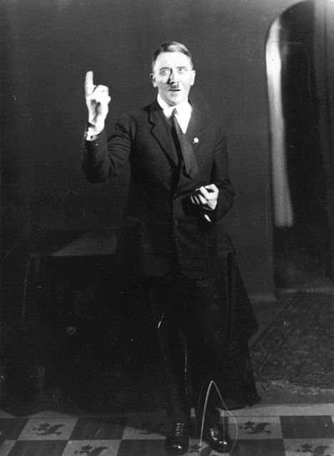 Adolf Hitler strikes a pose for photographer Heinrich Hoffmann while listening to a recording of his own speeches, 1925. After seeing the photographs, Hitler ordered Hoffmann to destroy the negatives, but he disobeyed.