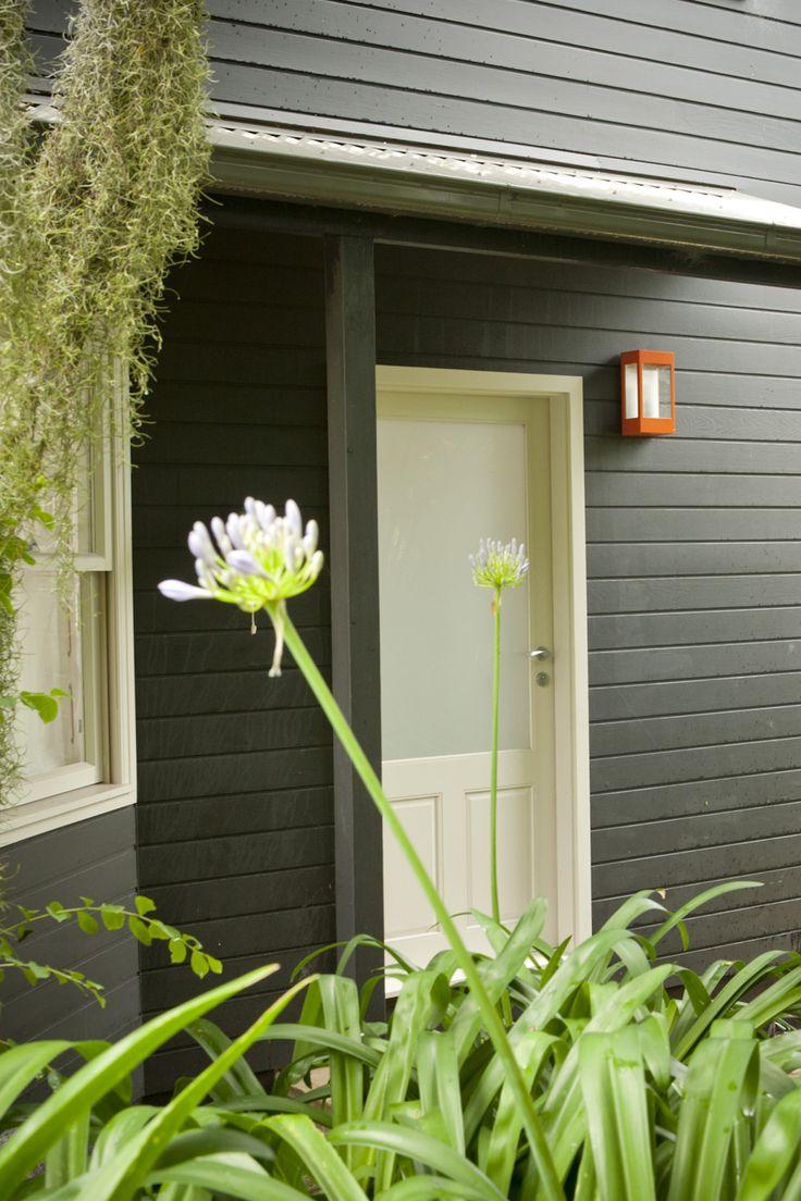 Front door. Weatherboarding painted in Porters Aniseed. Brooke Aitken Design.