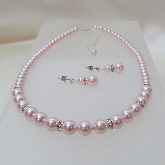 Hey, I found this really awesome Etsy listing at http://www.etsy.com/listing/107678754/swarovki-light-pink-pearl-necklace-and