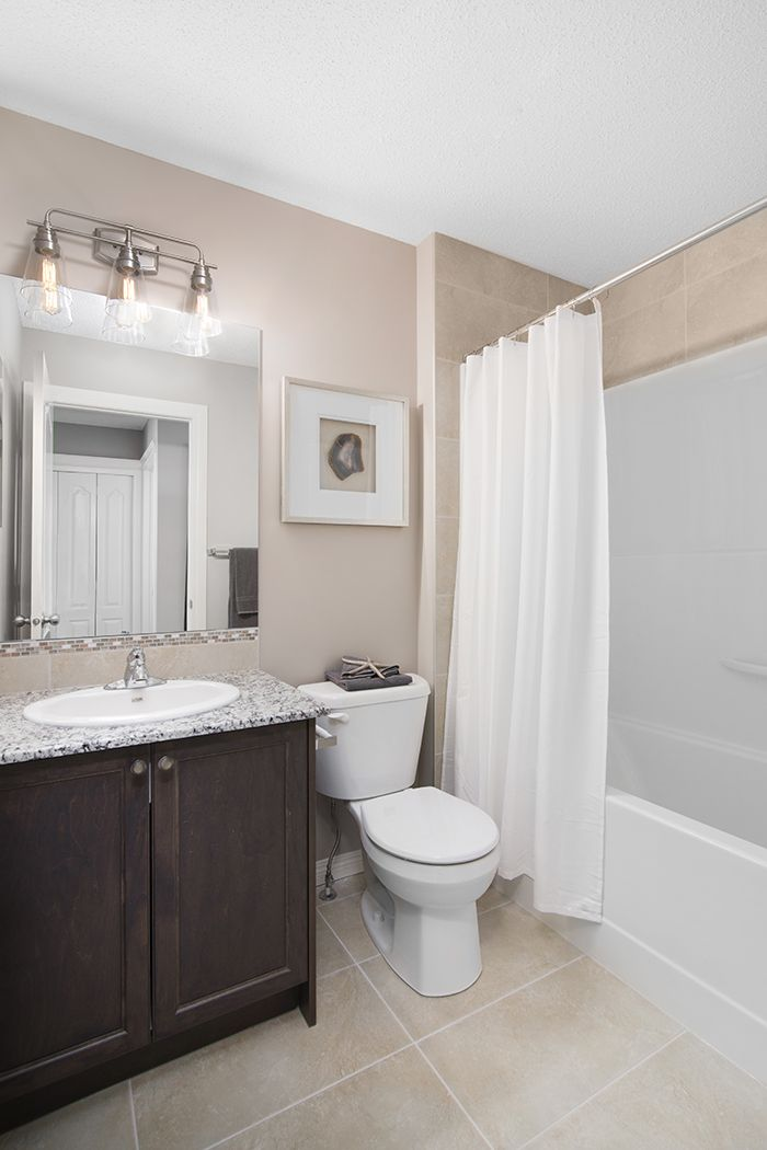 Main bath  in the Wysteria showhome in the community of Redstone in northeast Calgary