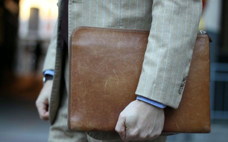 Mismo leather portfolio with chalk stripe flannel suit