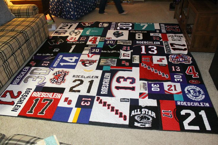 Nephew's hockey jersey quilt. Kept the laces on some jerseys, used large patches on front of jersey, and did photo transfers.