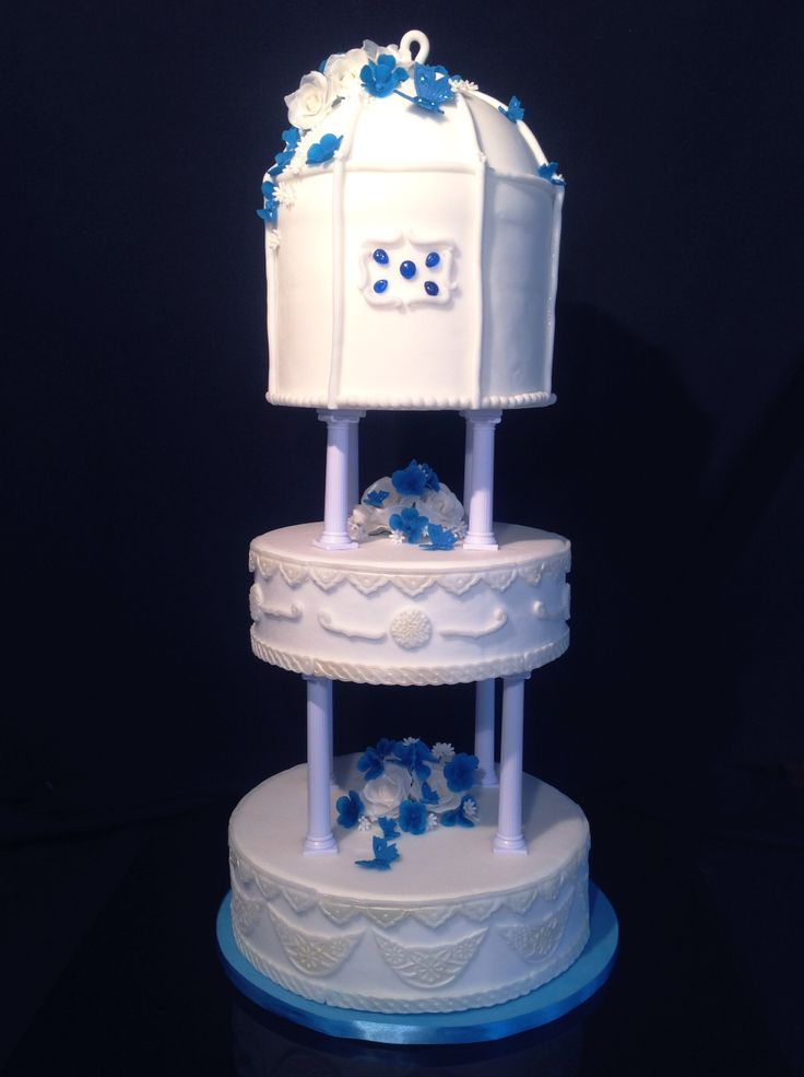 Wedding cake in blue with bushes of flowers