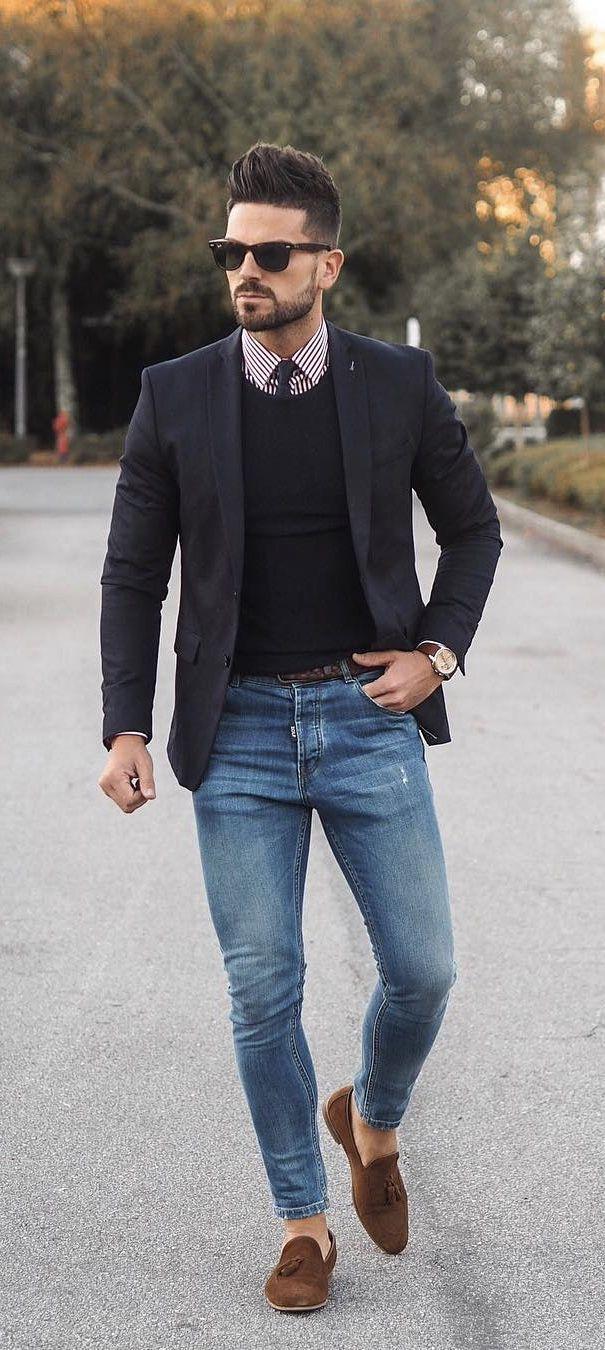 blue v neck sweater and black jeans men