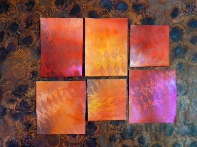 Square and rectangular embossed shapes created with Dylusions spray inks, clear embossed resist and Distress Inks.