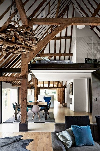 This modern rustic barn conversion with a small space saving mezzanine bedroom. Discover small space interior design ideas on House & Garden.