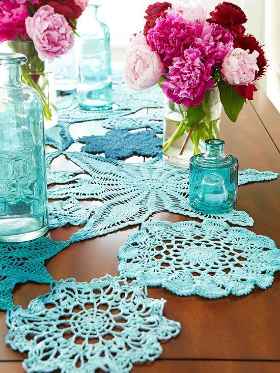 Hand-stitch vintage cotton doilies together to create a free-form table runner. For extra personalization, first dye the doilies. (We used three shades of blue to dye these.) By using different shades, the runner gets an ombre-style makeover.