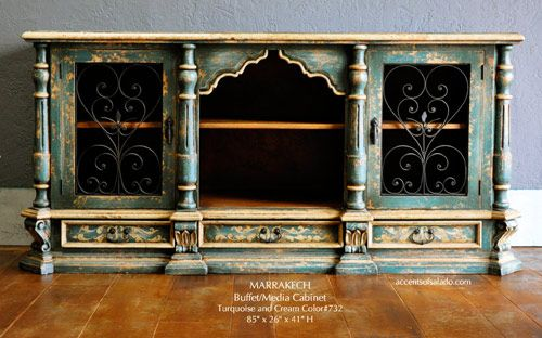 Two-tone distressed finish; hand-carved details; wrought iron accents.. Southwest Turquoise. Find it at Accents of Salado.