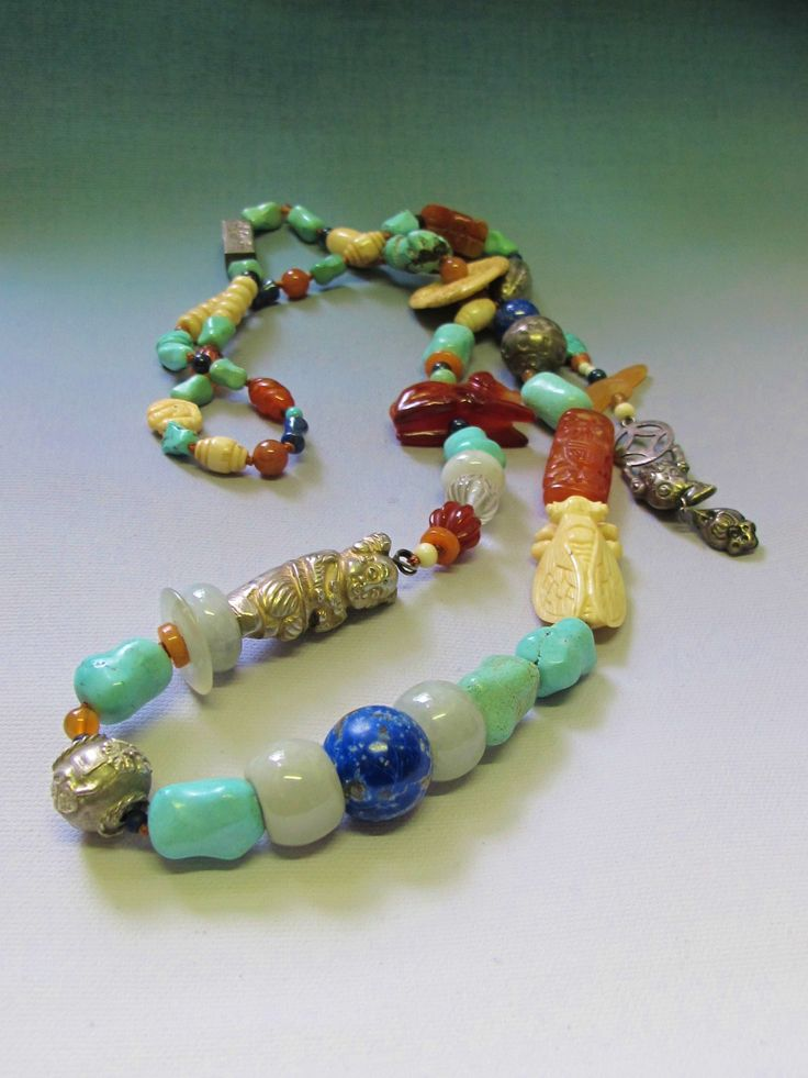 Antique Chinese beads of turquoise, silver, jade, carnelian, bone and silver fashioned in a wonderful necklace