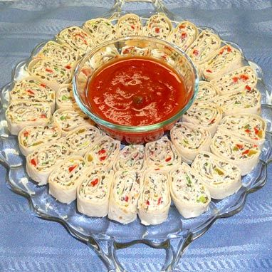 "TORTILLA ROLL-UPS  8 ozs. 	Cream Cheese 4 	Green Onions 1 2-oz. jar 	Pimientos, diced, optional 1 4-oz. can 	Green Chiles, diced 1 4.25-oz. can 	Black Olives, chopped 8 ozs. 	Flour Tortillas, six of 8"" diameter 1 cup 	Picante Sauce, optional  http://www.keithlangeneckert.com/Recipes/Appetizers/Tortilla%20Roll-Ups/"