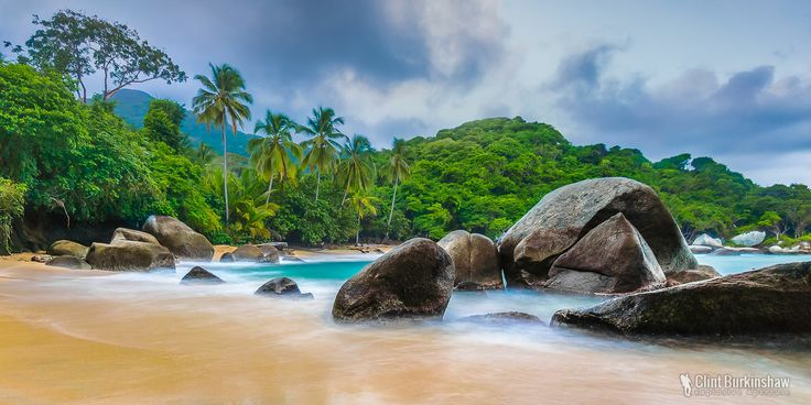 Parque Tayrona, Colombia  A national park on the northern Caribbean coast of Colombia, boasts some absolutely stunning beach scenes with unique boulders littering the coastline.  #Colombia #SouthAmerica #LandscapePhotography #SeascapePhotography