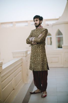 Groom Wear - Ankit & Prerna wedding story | WedMeGood | Groom in a Beige and Gold Sherwani with Marsala Dhoti Pants #wedmegood #indiangroom #indianwedding #sherwani #groomwear #weddingwear