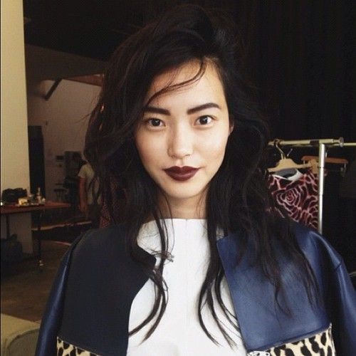 When wearing a dark lipstick, the eyebrows must be full and thick to balance the…