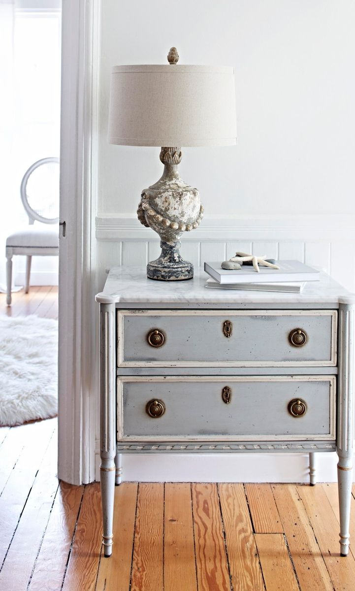 A nonchalant beauty, the Etienne Bedside Chest was inspired by a French antique, with honed Carrera marble top, French blue finish and white edging.