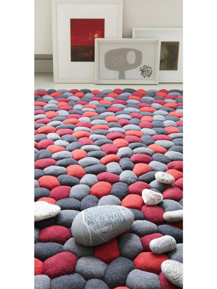http://www.benuta.de/teppich-pebbles-rot-3.html  PEBBLE aus der aktuellen benuta-Kollektion versprüht jugendlichen Charme und stylishes Trendbewusstsein. Das innovative, reliefartige Design aus 100% Wolle zieht die Blicke auf sich und macht jeden Raum zu etwas Besonderem.