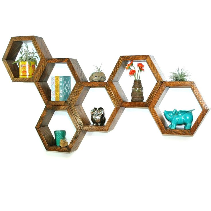 This listing is for a single hexagon. Purchase 6 hexagons to build a honeycomb like the photo.  Reclaimed wood floating hexagon shelves hand-crafted from vintage utility pole salvage. Only the finest Douglas Fir timber is used in the utility pole industry and after each pole is cut to length a high quality remnant remains. These beautiful and often gigantic timber cutoffs have been rescued from a log yard where their fate was sealed as firewood. Given new life at a vintage mill in Washington…