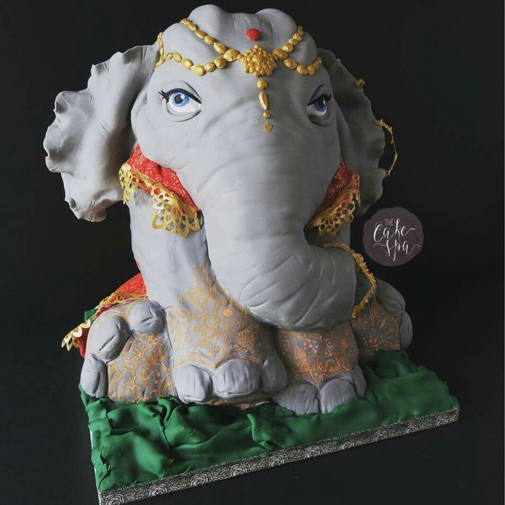 Indian inspired sculpted elephant cake with henna and headdress