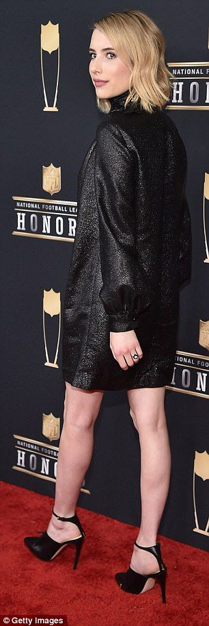 Looking pretty: The actress looked chic in a black, shift dress with bubble sleeves...