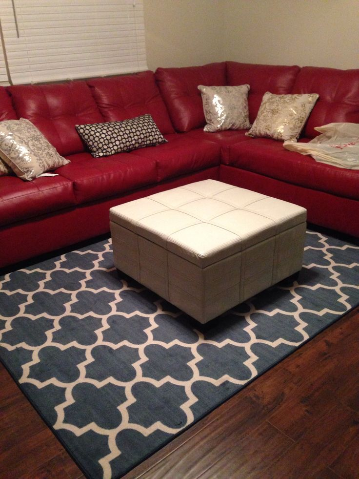 Who New Red Couches And That Rug Would Go Together. I Kinda Like