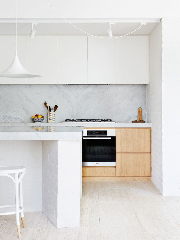 The Westgarth Home of Bella Stagoll and family, designed by Melbourne architects Kennedy Nolan. Photo – Annette O'Brien. Production – Lucy Feagins / The Design Files. White, timber look and marble / Carrara stone in kitchen = yes!